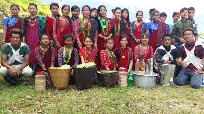 Bhachok youths pose with various recipes during Lhosar. Picture: Pabitra Gurung