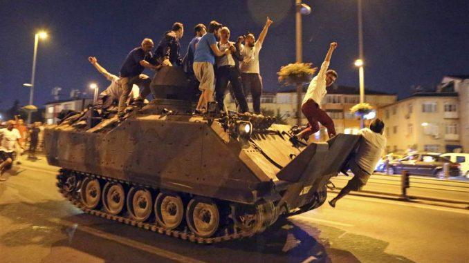 Protesters climb onto a tank in Istanbul.TOLGA BOZOGLU/EPA