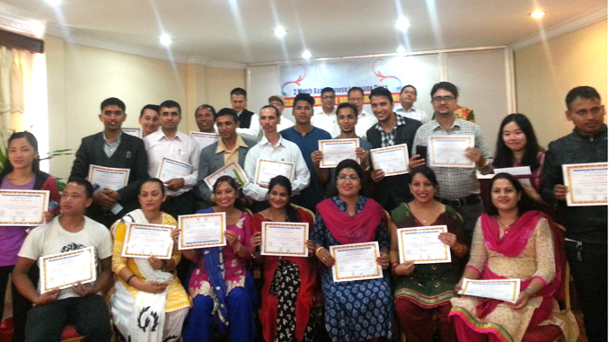 Participants pose for a photograph after reeving the certificate of Chinese language tanning in Pokhara on Monday. Picture: Recentfusion.com