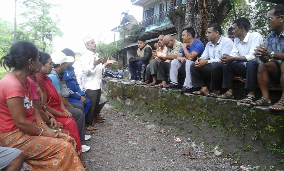 An informal meeting to save the Dobilla bridge and settlement. Picture: Keshab Thapa/FB