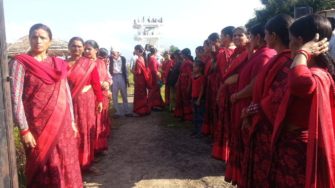 Women group ready to welcome their guests of press meet in Pumdikot on Saturday. Picture: Recentfusion.com