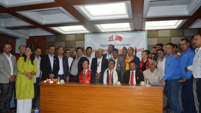 Posing for a group picture during solar light signing ceremony held in Pokhara on Monday. Picture: PCCI
