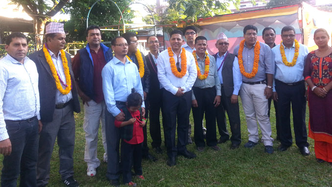 WRHA Pokhara executives and other guests during 10th Bhai Tika Festival 2073 in Pokhara on Tuesday. Picture: Recentfusion.com