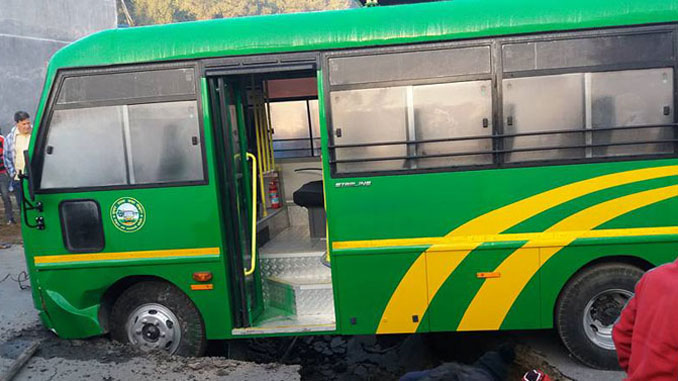 A bus stalemates as it met with a sinkhole in Pokhara on Tuesday. Picture: Onlinekhabar.com